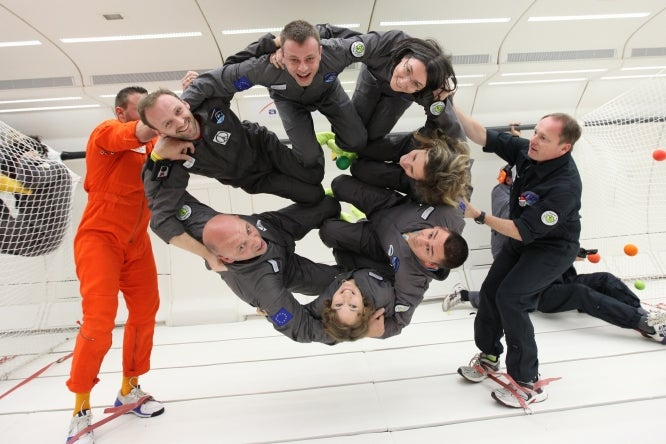 Frank Diard and experience weightlessness during their Zero G flight