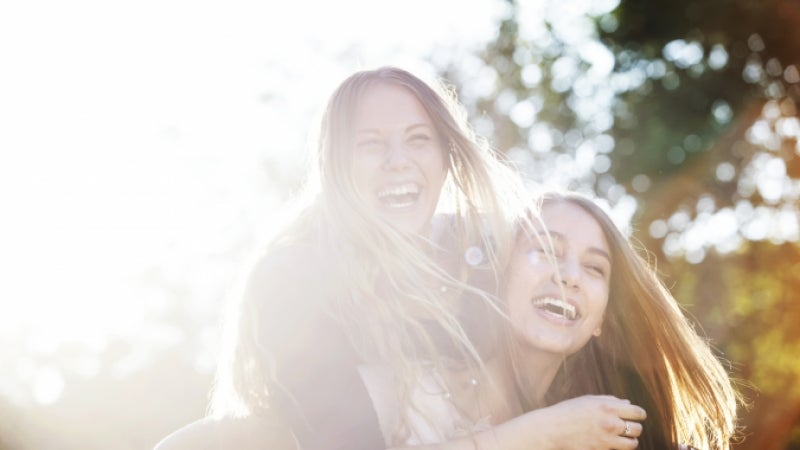 A pair of happy-looking young women