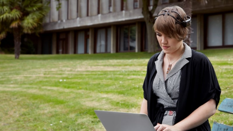 Award-winning research scientist Nataliya Kosmyna wearing the headset she uses to control objects with her mind