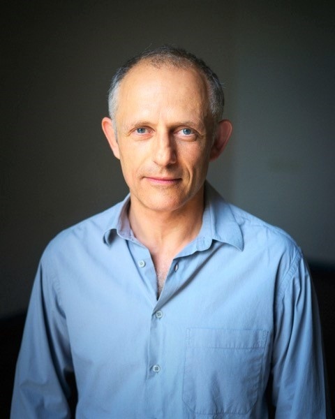 Portrait image of theatre director and acting teacher Paul Golub