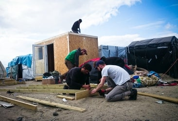 Volunteers building a shelter at the Calais Jungle